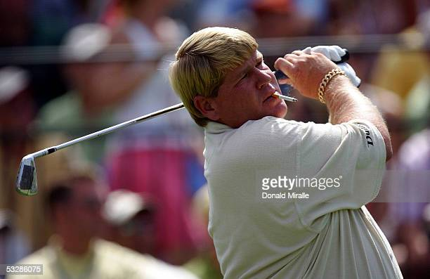 John Daly hits on the practice range with a cigarette in his mouth during the Battle at the Bridges on July 25 2005 at The Bridges at Rancho Sante Fe...