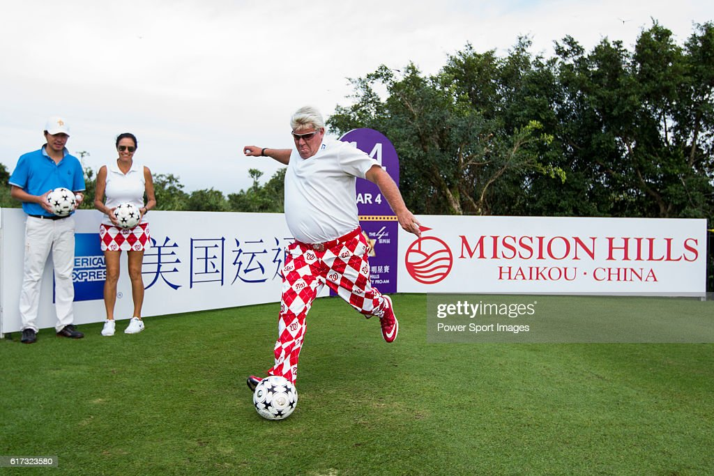 John Daly kicks a football at the 14th hole of the World Celebrity Pro-Am 2016 Mission Hills China Golf Tournament on 21 October 2016, in Haikou, China.