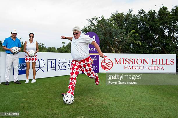 John Daly kicks a football at the 14th hole of the World Celebrity ProAm 2016 Mission Hills China Golf Tournament on 21 October 2016 in Haikou China
