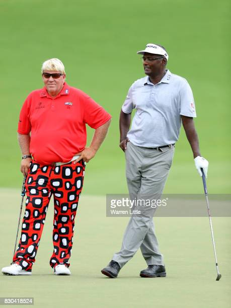 John Daly of the United States and Vijay Singh of Fiji wait to putt on the 18th green during the second round of the 2017 PGA Championship at Quail...