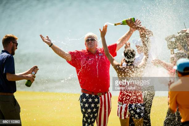 John Daly of the United States is sprayed with champagne at the eighteenth green following his victory at the PGA TOUR Champions Insperity...