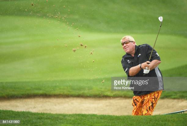John Daly of the United States play from a bunker on the 12th hole during day two of the DD REAL Czech Masters at Albatross Golf Resort on September...