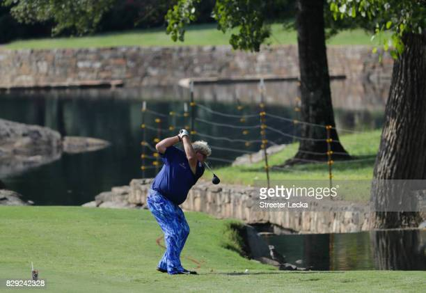 John Daly of the United States plays his shot on the seventh hole during the first round of the 2017 PGA Championship at Quail Hollow Club on August...