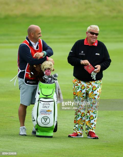 John Daly of the United States shares a joke with caddie Simon Hurd on the 3rd hole during day three of the Made in Denmark at Himmerland Golf Spa...