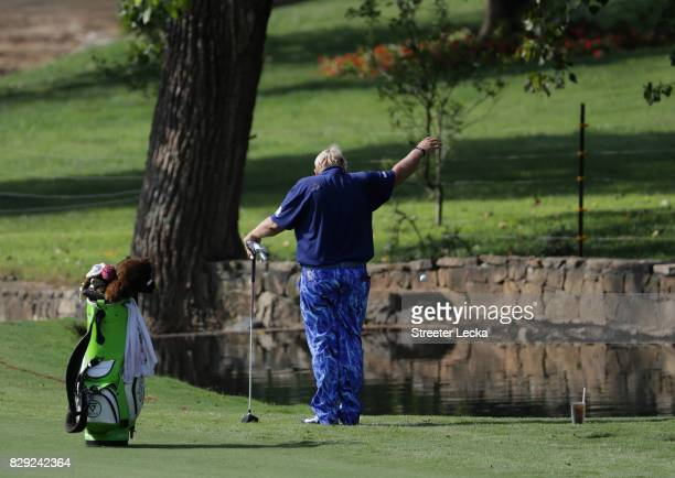 John Daly of the United States takes a drop on the seventh hole during the first round of the 2017 PGA Championship at Quail Hollow Club on August 10...