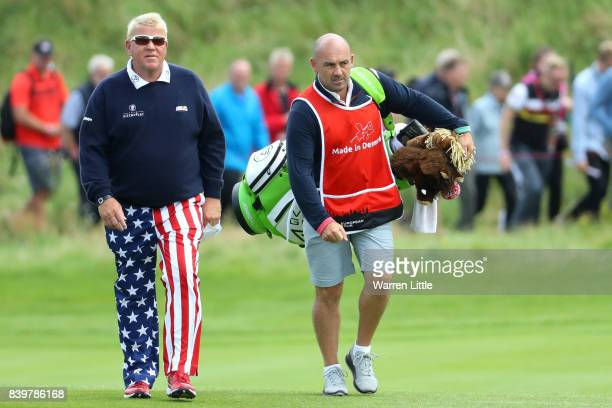 John Daly of the United States walks with caddie Simon Hurd on the 3rd hole during the final round of Made in Denmark at Himmerland Golf Spa Resort...