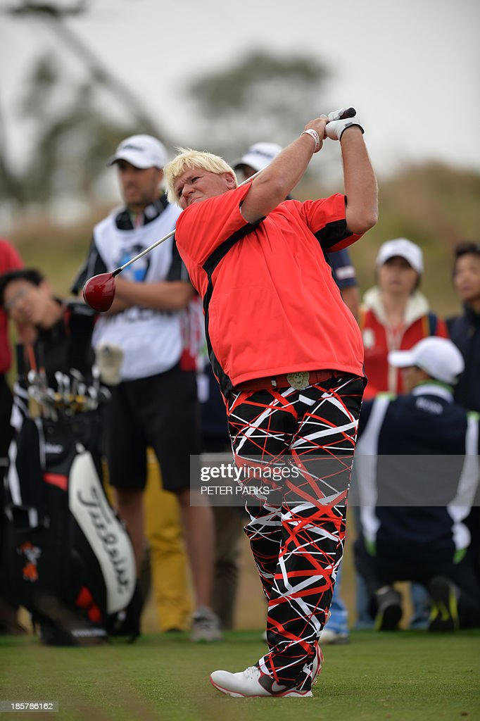 John Daly of the US hits a tee shot at the second hole during the second round of the BMW Shanghai Masters golf tournament at the Lake Malaren Golf Club in Shanghai on October 25, 2013. AFP PHOTO/Peter PARKS