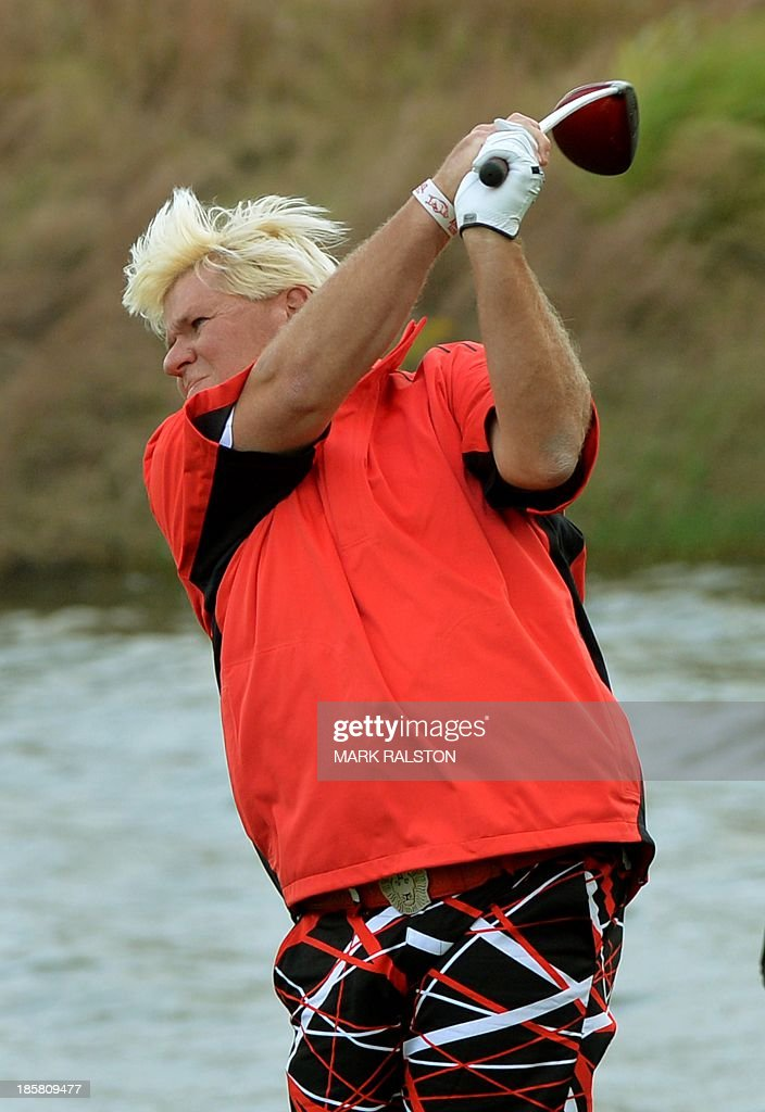 John Daly of the US tees off at the 9th hole during day two of the BMW Shanghai Masters golf tournament at the Lake Malaren Golf Club in Shanghai on October 25, 2013. The 7 million USD event is being held for the second time at the Lake Malaren Golf Club. AFP PHOTO/Mark RALSTON