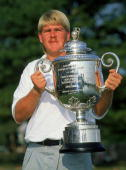 John Daly of the USA holds the trophy after winning the USPGA Championship at Crooked Stick in Carmel Indiana USA in August 1991