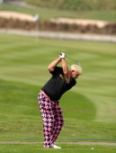 John Daly of USA plays a shot during his practice round of the Thailand Golf Championship at Amata Spring Country Club on December 13 2011 in...