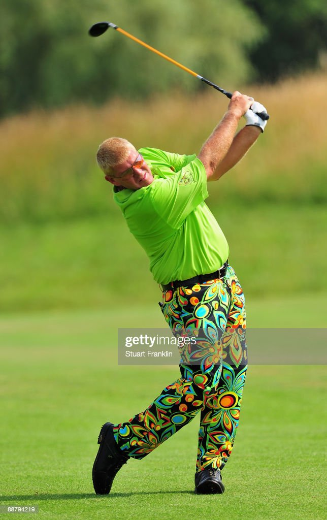 John Daly of USA plays his approach shot on the 14th hole during the first round of the Open de France ALSTOM at the Le Golf National Golf Club on...