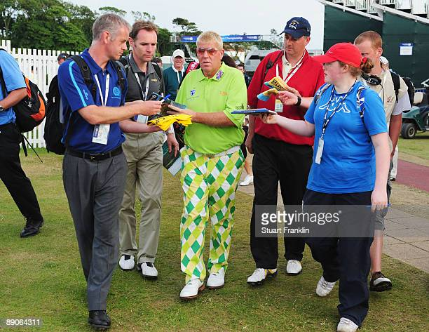 John Daly of USA signs autographs during round one of the 138th Open Championship on the Ailsa Course Turnberry Golf Club on July 16 2009 in...