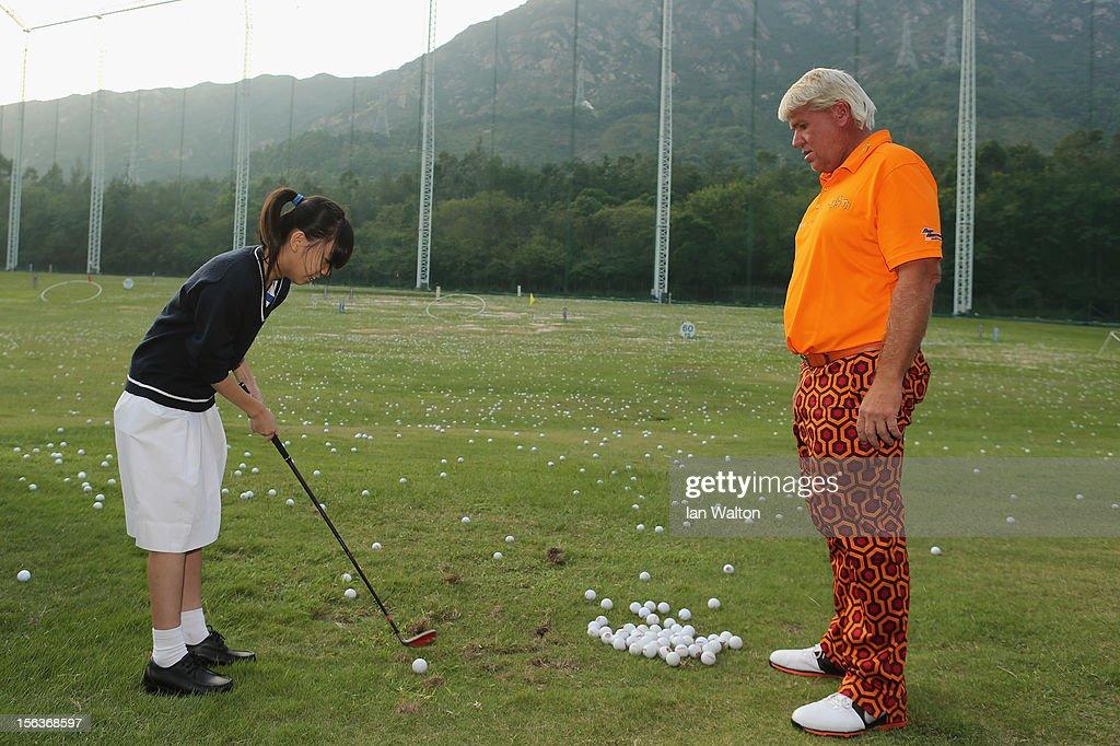 John Daly of USA takes part in a Junior Golf Clinic at Tuen Mun Golf Centre on November 14, 2012 in Hong Kong, Hong Kong.