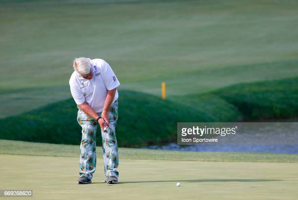John Daly putts on the 18th green during the final round of the Mitsubishi Electric Classic tournament at the TPC Sugarloaf Golf Club Sunday April 16...