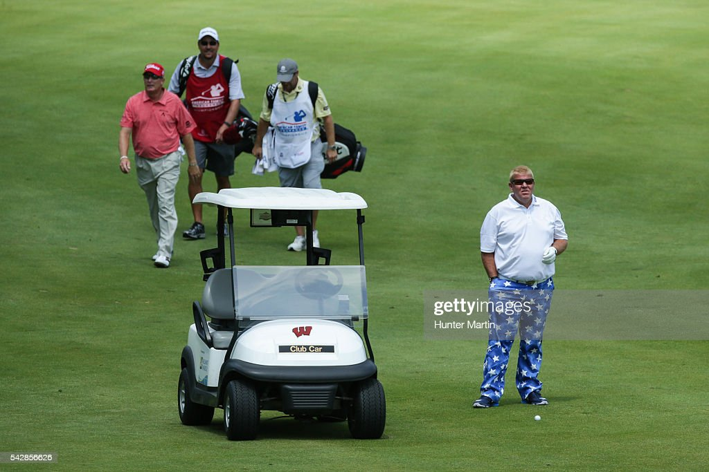 <a gi-track='captionPersonalityLinkClicked' href=/galleries/search?phrase=John+Daly+-+Golfer&family=editorial&specificpeople=4350901 ng-click='$event.stopPropagation()'>John Daly</a> stands next to his cart on the 18th hole during the first round of the Champions Tour American Family Insurance Championship at University Ridge Golf Course on June 24, 2016 in Madison, Wisconsin.