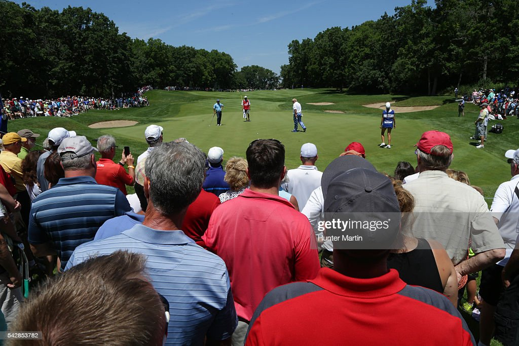 <a gi-track='captionPersonalityLinkClicked' href=/galleries/search?phrase=John+Daly+-+Golfer&family=editorial&specificpeople=4350901 ng-click='$event.stopPropagation()'>John Daly</a> walks to his ball as fans watch on the 14th hole during the first round of the Champions Tour American Family Insurance Championship at University Ridge Golf Course on June 24, 2016 in Madison, Wisconsin.