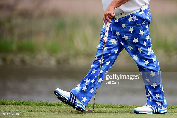 John Daly walks to the 18th green during the second round 2016 Senior PGA Championship presented by KitchenAid at the Golf Club at Harbor Shores on...