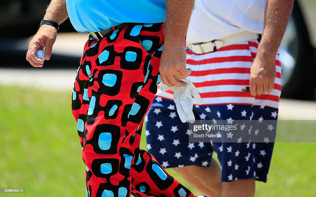 John Daly walks with a fan to the third hole during the first round of the Insperity Championship at The Woodlands Country Club on May 06, 2016 in The Woodlands, Texas.