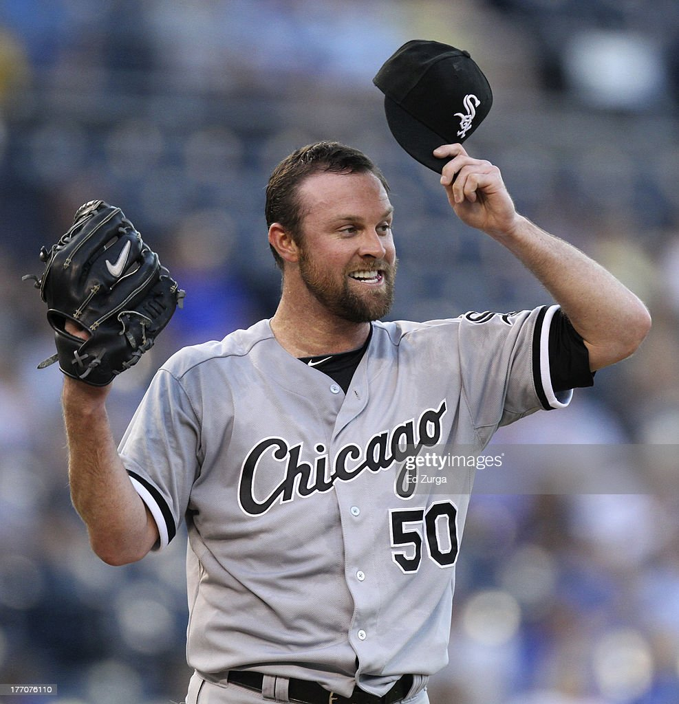 <a gi-track='captionPersonalityLinkClicked' href=/galleries/search?phrase=John+Danks&family=editorial&specificpeople=835613 ng-click='$event.stopPropagation()'>John Danks</a> #50 of the Chicago White Sox puts his cap on as he prepares to pitch against the Kansas City Royals in the first inning at Kauffman Stadium August 20, 2013 in Kansas City, Missouri.