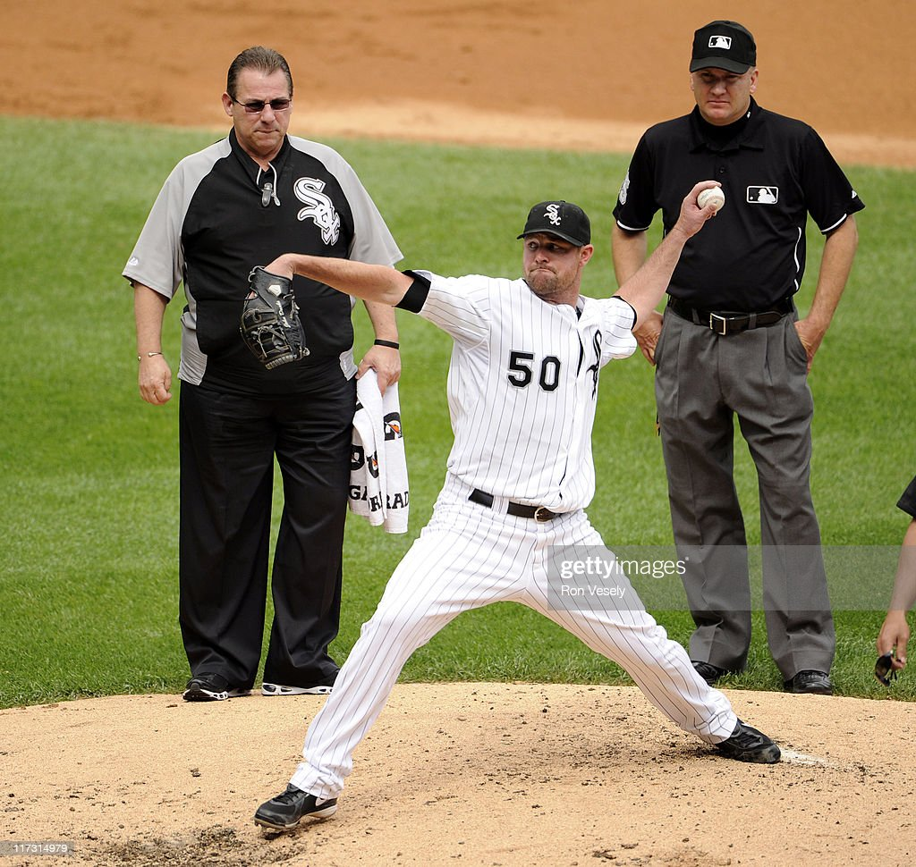 <a gi-track='captionPersonalityLinkClicked' href=/galleries/search?phrase=John+Danks&family=editorial&specificpeople=835613 ng-click='$event.stopPropagation()'>John Danks</a> #50 takes a practice pitch under the eye of head trainer Herm Schneider of the Chicago White Sox after Danks was injured in the second inning against the Washington Nationals on June 25, 2011 at U.S. Cellular Field in Chicago, Illinois. Danks had to leave the game.