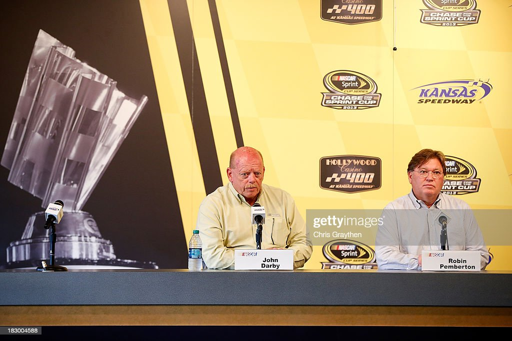 John Darby, NASCAR Sprint Cup Series Director, and Robin Pemberton, NASCAR Vice President of Competition speak to the media following for the NASCAR Sprint Cup Series at Kansas Speedway on October 3, 2013 in Kansas City, Kansas.
