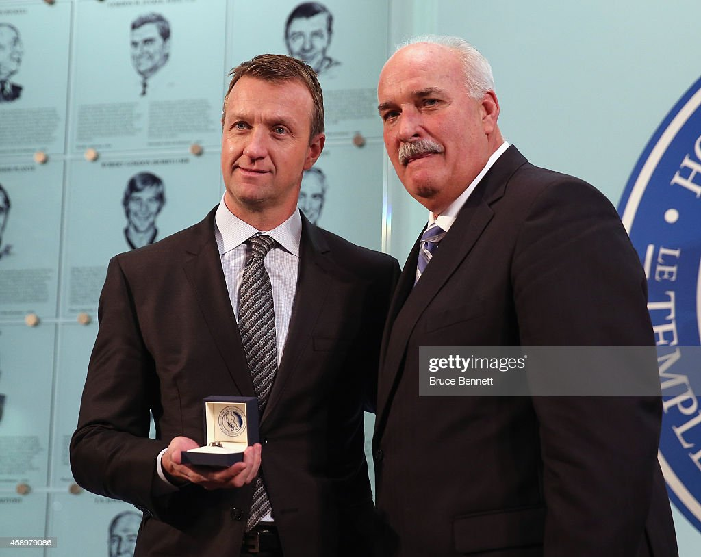 John Davidson Chairman of the Hockey Hall of Fame Selection Committee presents the Hall of Fame ring to 2014 inductee Rob Blake during a photo...