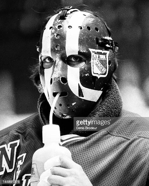 John Davidson of the New York Rangers drinks water during a break in the action of a game against the Montreal Canadiens Circa 1977 at the Montreal...