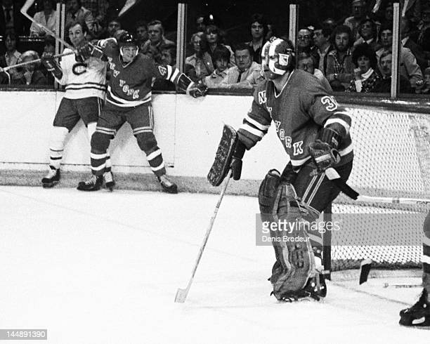 John Davidson of the New York Rangers follows the action during a game against the Montreal Canadiens Circa 1977 at the Montreal Forum in Montreal...