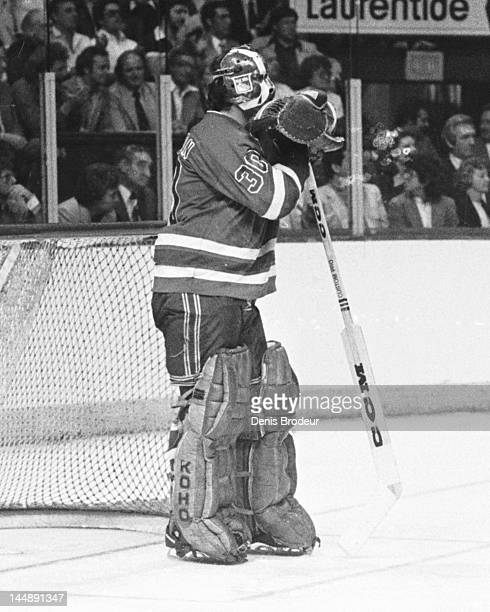 John Davidson of the New York Rangers leans on his stick during a break in the action against the Montreal Canadiens Circa 1977 at the Montreal Forum...