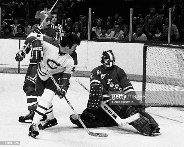 John Davidson of the New York Rangers saves a shot by Yvon Lambert of the Montreal Canadiens Circa 1977 at the Montreal Forum in Montreal Quebec...