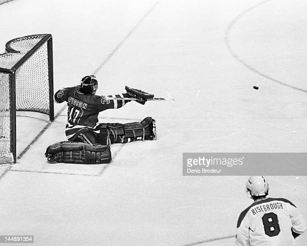 John Davidson of the New York Rangers saves a shot taken by Doug Risebrough of the Montreal Canadiens Circa 1977 at the Montreal Forum in Montreal...