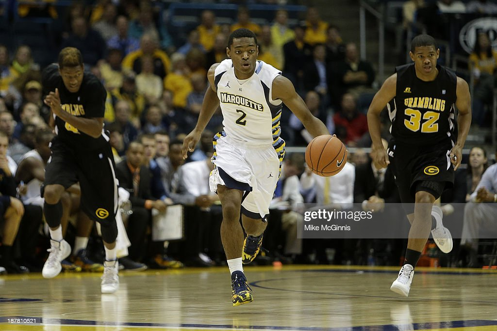 John Dawson #2 of the Marquette Golden Eagles dribbles up the court on a fast break in the first half against the Grambling State Tigers at BMO Harris Bradley Center on November 12, 2013 in Madison, Wisconsin.