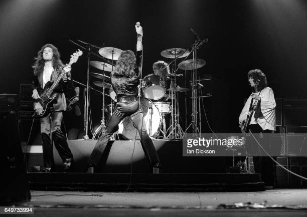 John Deacon Freddie Mercury Roger Taylor and Brian May of Queen perform on stage on the 'Sheer Heart Attack' tour Rainbow Theatre London 19 November...