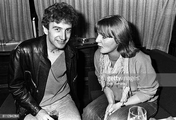 John Deacon of Queen and journalist Annemarie den Daas on board a train from Leiden to Amsterdam Netherlands after a gig at Groenoordhal Leiden 25th...