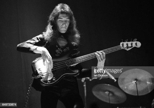 John Deacon of Queen performs on stage on the 'Queen II' tour Rainbow Theatre London 31 March 1974