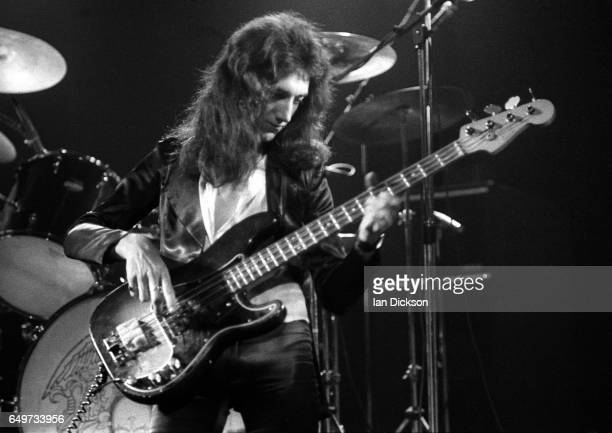 John Deacon of Queen performs on stage on the 'Sheer Heart Attack' tour Rainbow Theatre London 19 November 1974 They are wearing Zandra Rhodes...