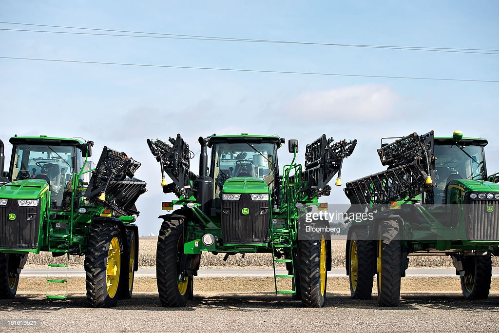 John Deere agricultural sprayers sit outside Klein Equipment, a John Deere dealership in Galesburg, Illinois, U.S., on Tuesday, Feb. 12, 2013. Deere & Co., the world's largest maker of agricultural equipment, is scheduled to release quarterly earnings on Feb. 13. Photographer: Daniel Acker/Bloomberg via Getty Images