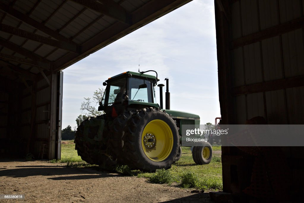 A John Deere & Co. tractor backs into a barn in Malden, Illinois, U.S., on Tuesday, May 16, 2017. Rain in the Midwest and Great Plains will slow corn, soybean and wheat planting progress as well as curb seed germination and early growth, according to a senior meteorologist at the MDA Weather Services. Photographer: Daniel Acker/Bloomberg via Getty Images
