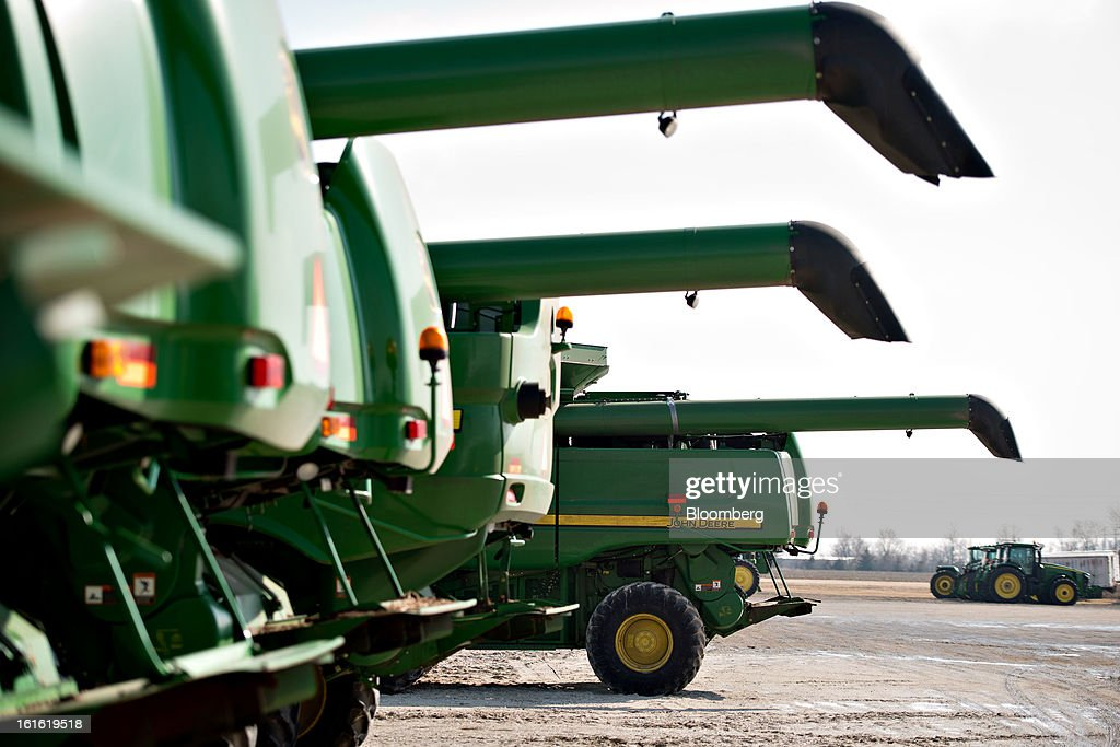 John Deere combine harvesters sit outside Klein Equipment, a John Deere dealership in Galesburg, Illinois, U.S., on Tuesday, Feb. 12, 2013. Deere & Co., the world's largest maker of agricultural equipment, is scheduled to release quarterly earnings on Feb. 13. Photographer: Daniel Acker/Bloomberg via Getty Images