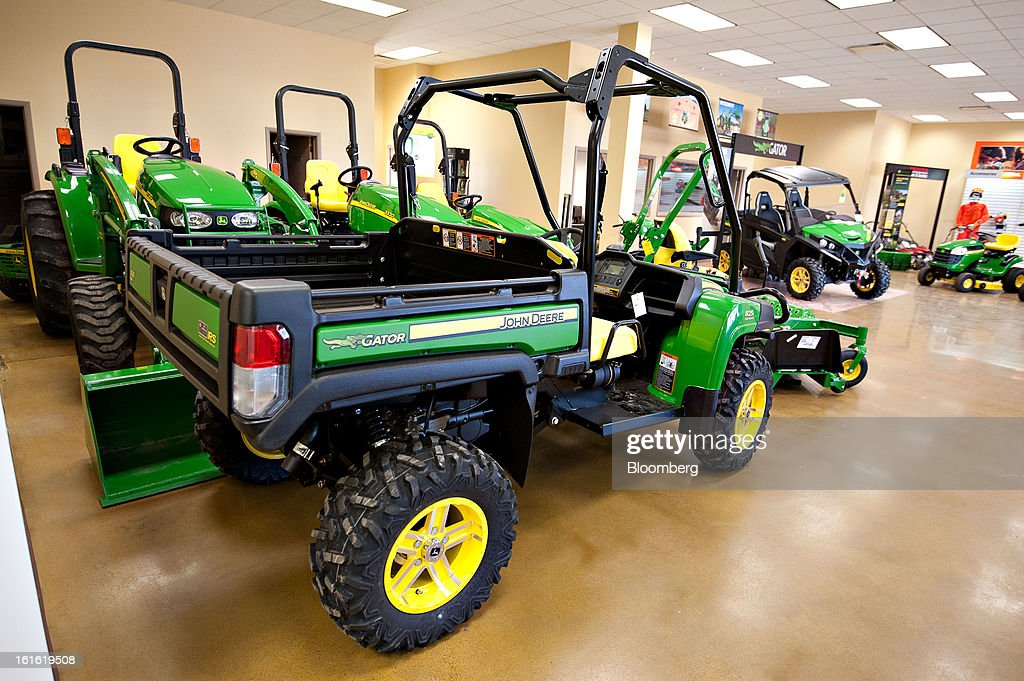 A John Deere Gator 4x4 utility vehicle sits on display at Klein Equipment, a John Deere dealership in Galesburg, Illinois, U.S., on Tuesday, Feb. 12, 2013. Deere & Co., the world's largest maker of agricultural equipment, is scheduled to release quarterly earnings on Feb. 13. Photographer: Daniel Acker/Bloomberg via Getty Images
