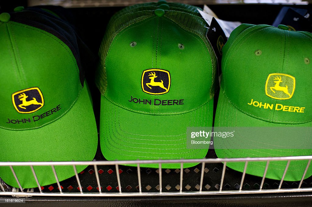 John Deere hats sit on display at Klein Equipment, a John Deere dealership in Galesburg, Illinois, U.S., on Tuesday, Feb. 12, 2013. Deere & Co., the world's largest maker of agricultural equipment, is scheduled to release quarterly earnings on Feb. 13. Photographer: Daniel Acker/Bloomberg via Getty Images