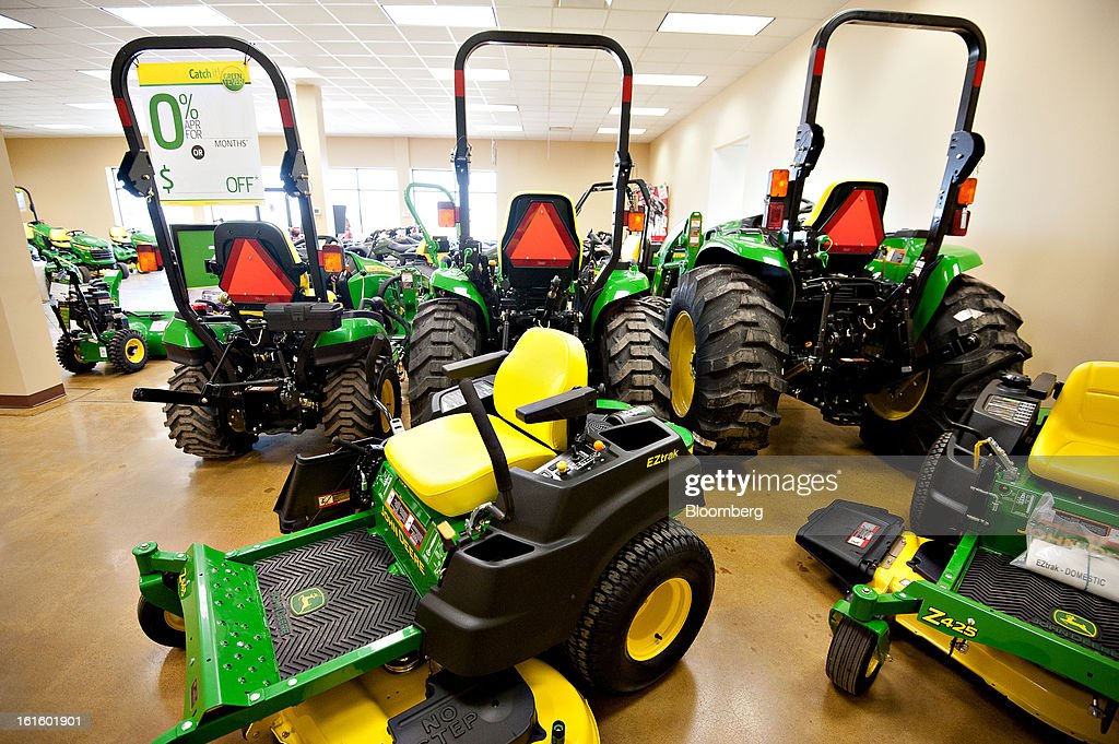 John Deere lawn and farm tractors sit on display at Klein Equipment, a John Deere dealership, in Galesburg, Illinois, U.S., on Tuesday, Feb. 12, 2013. Deere & Co., the world's largest maker of agricultural equipment, is scheduled to release quarterly earnings on Feb. 13. Photographer: Daniel Acker/Bloomberg via Getty Images