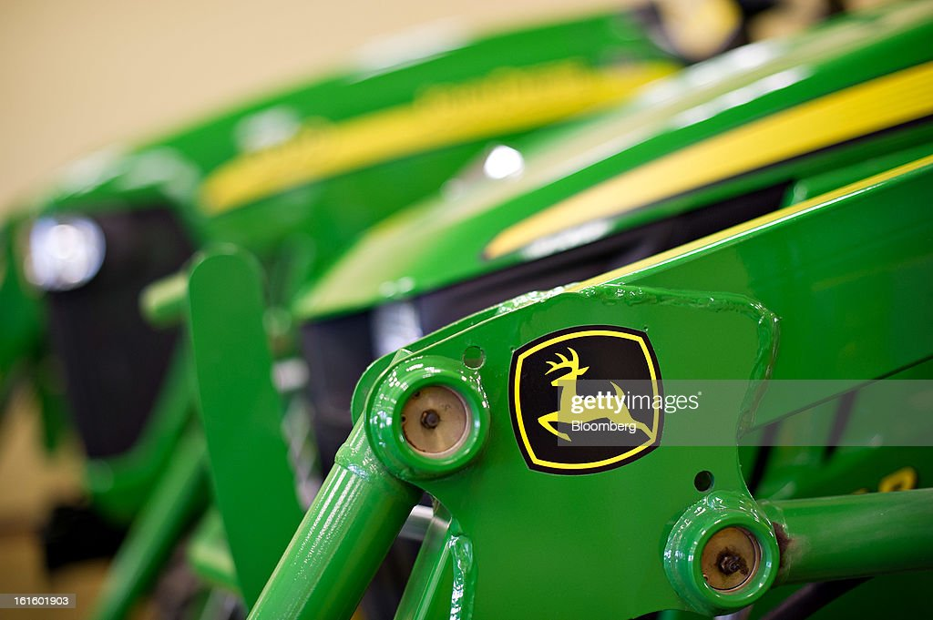 A John Deere logo appears on the loading arm of a tractor at Klein Equipment, a John Deere dealership, in Galesburg, Illinois, U.S., on Tuesday, Feb. 12, 2013. Deere & Co., the world's largest maker of agricultural equipment, is scheduled to release quarterly earnings on Feb. 13. Photographer: Daniel Acker/Bloomberg via Getty Images