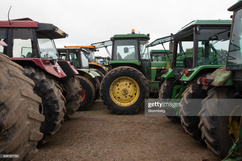A John Deere tractor, manufactured by Deere & Co., sits at the Cheffins Cambridge Machinery Sales monthly machinery and plant auction in Sutton, U.K., on Monday, Sept. 4, 2017. The debate over food andfarmingpolicy after Brexit has heated up recently, with Environment Secretary Michael Gove telling BBC Radio 4 that the U.K wouldnt lower its animal welfare or environmental standards to achieve any new trade deals. Photographer: Simon Dawson/Bloomberg via Getty Images