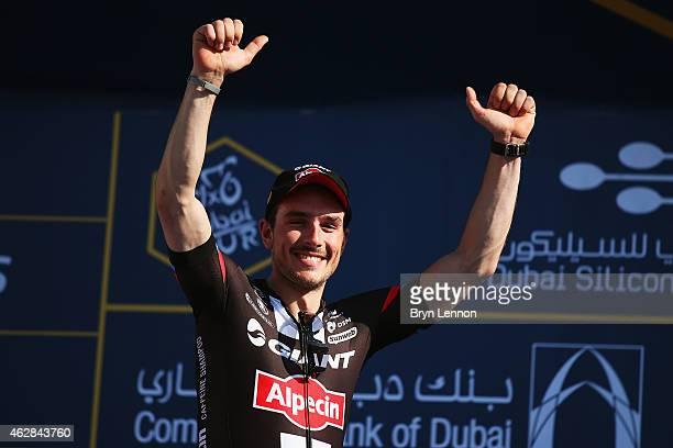 John Degenkob of Germany and Team GiantAlpecin celebrates with team mate Luka Mezgec of Slovenia winning stage three of the Dubai Tour from the Dubai...