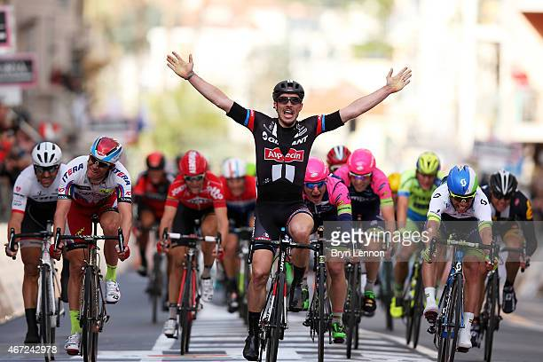 John Degenkolb of Germany and Team Giant Alpecin celebrates as he crosses the finish line to win the 2015 MilanSanRemo cycle race on March 22 2015 in...