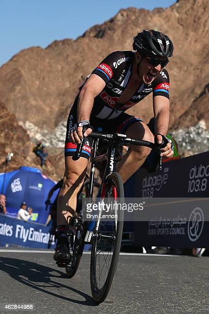John Degenkolb of Germany and Team GiantAlpecin crosses the finish line after winning stage three of the Dubai Tour from the Dubai International...
