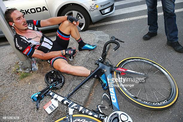 John Degenkolb of Germany and Team GiantAlpecin rests on the pavement after stage thirteen of the 2015 Tour de France a 1985 km stage between Muret...