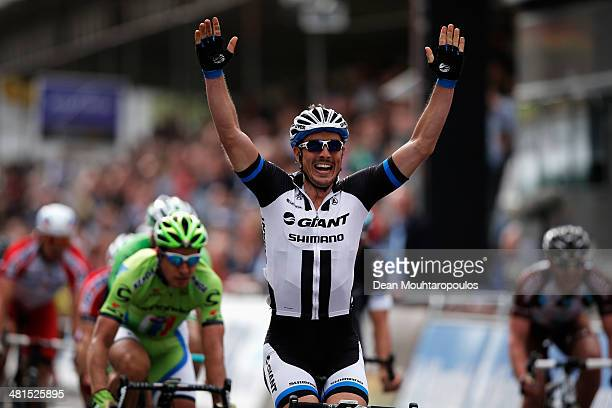 John Degenkolb of Germany celebrates as he crosses the finish line ahead of Arnaud Demare of France and Peter Sagan of Slovakia during the...