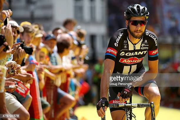 John Degenkolb of Germany riding for GiantAlpecin signs in and proceeds to the start of stage three of the 2015 Tour de France from Anvers to Huy on...